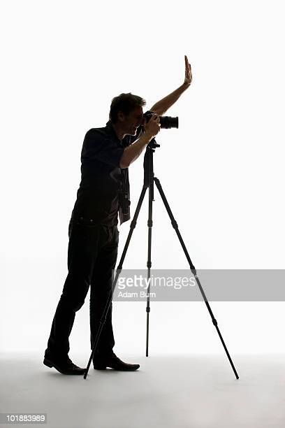 A photographer working with a camera on a tripod