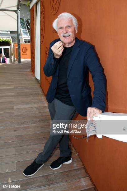 Photographer Yann ArthusBertrand attends the 2017 French Tennis Open Day Thirteen at Roland Garros on June 9 2017 in Paris France