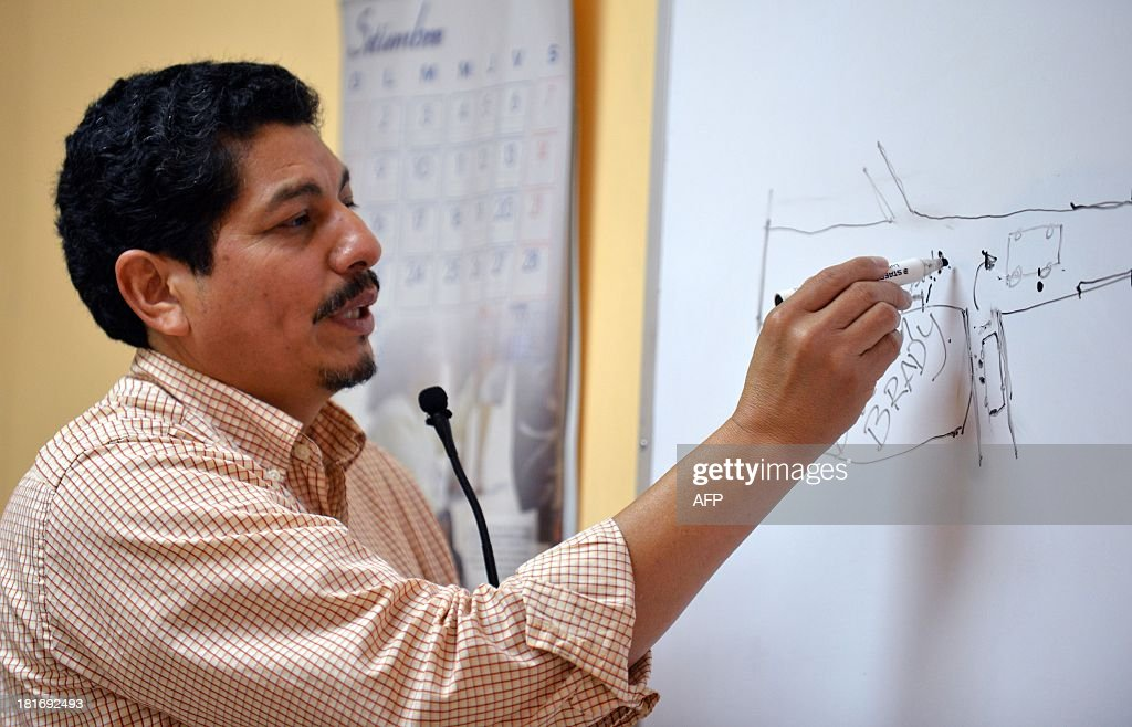 AFP photographer Yuri Cortez explains in court in Puntarenas, 77 km southwest of San Jose, how he was shot at by hired bodyguards during the wedding of Brazilian top model Gisele Bundchen and US football player Tom Brady in Playa Santa Teresa in Puntarenas in 2009.