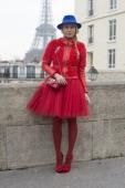 Photographer Zhanna Roma wears a Cloud X jacket Dior skirt Maison Michel hat Cassadei shoes and a Paula Cademartori bag on day 2 of Paris Womens...