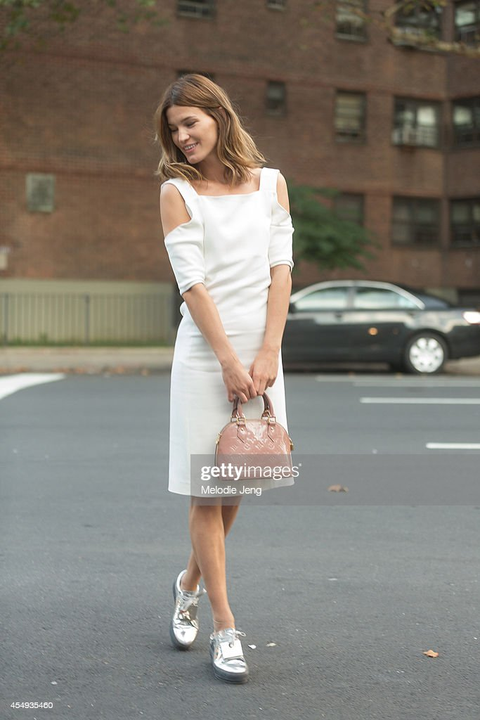 Photographer/Blogger Hanneli Mustaparta wears a Edun dress with a Louis Vuitton bag and Acne shoes after Edun on Day 4 of New York Fashion Week...