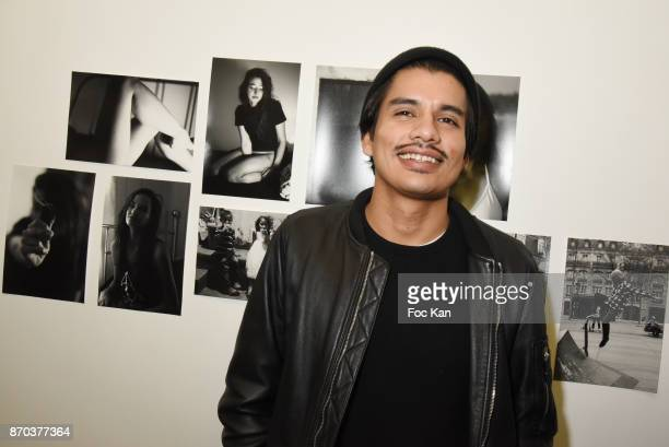 Photographer/musician Jonathan Velasquez poses with his personal work during the Larry Clark and Jonathan Velasquez Photo Exhibition as part of Larry...