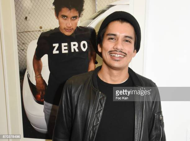Photographer/musician Jonathan Velasquez posess with his portraits by Larry Clark during the Larry Clark and Jonathan Velasquez Photo Exhibition as...