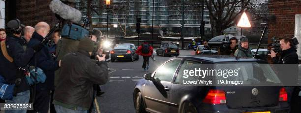 Photographers and fim crews follow Kate Middleton's car outside her house in London on her 25th birthday