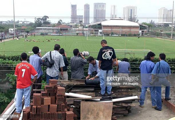 Photographers and supporters on a rooftop trying to catch a glimpse of Manchester Uniteds training session at FlaBarra near Rio de Janeiro in Brazil...