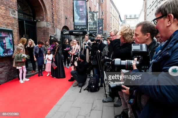 Photographers and the people behind the documentary 'Jaha's Promise' wait on the red carpet for Crown Princess Mary to arrive at the Grand Theatre on...