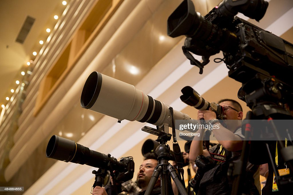 Photographers and videographers attend a speech by Li Keqiang, China premier, unseen, at the Boao Forum for Asia in Boao, Hainan, China, on Thursday, April 10, 2014. Li said China plans to connect the stock exchanges of Hong Kong and Shanghai as part of efforts to expand the nation's capital markets. Photographer: Brent Lewin/Bloomberg via Getty Images