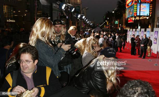Photographers are asked to wear Hannah Montana wigs at the premiere for new film Hannah Montana and Miley CyrusBest of Both Worlds Concert at the El...