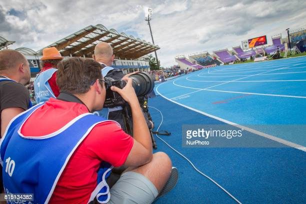 Photographers are seen waiting at the finish line for the 100 meter womens final at the European U23 IAAF Champioships on 14 July 2017