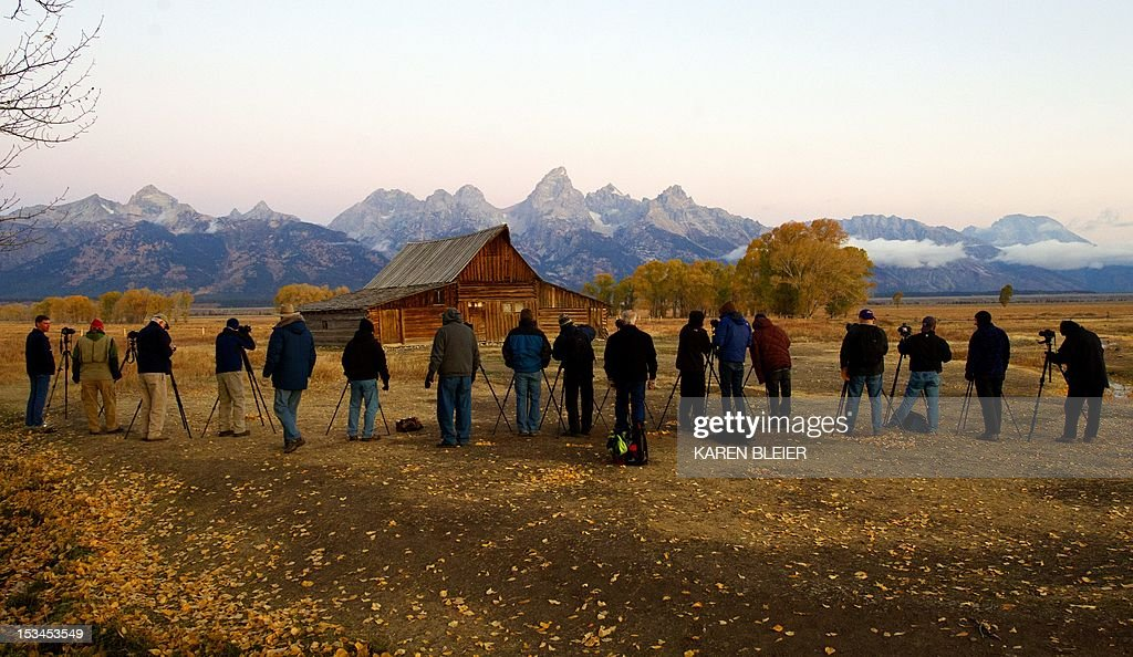Photographers await sunrise in freezing temperatures at the Moulton barn October 5 2012 in the Grand Teton National Park in Wyoming Grand Teton...