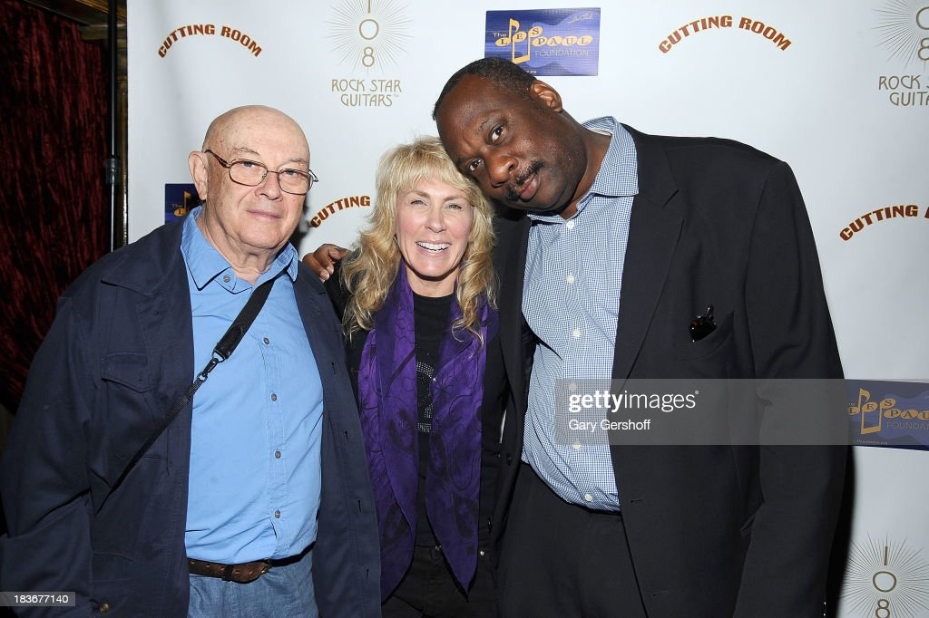 Photographers Bruce Davidson, Lisa Johnson and Gene Shaw attend the book launch and performance for '108 Rock Star Guitars' benefitting The Les Paul Foundation at The Cutting Room on October 8, 2013 in New York City.