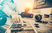 photographer journalist camera traveling photo dslr editing edit hobbies lighting business designer concept - stock image NOTE TO INSPECTOR: All visible photos were produced for this particular shoot.