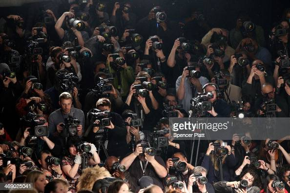 Photographers cover the Betsey Johnson show at MercedesBenz Fashion Week Fall 2014 at Lincoln Center for the Performing Arts on February 12 2014 in...