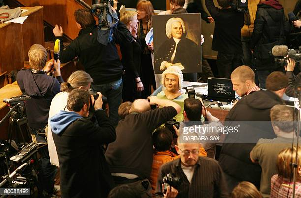 Photographers crowd around the reconstruction of the face of late German composer Johann Sebastian Bach during its presentation on March 3 2008 at...