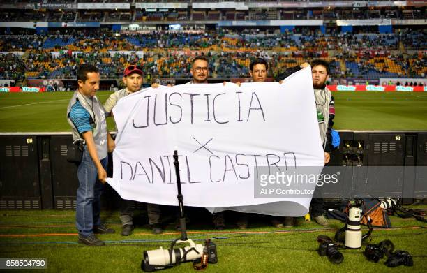 Photographers display a banner to protest against the murder of Mexican photojournalist Edgar Daniel Castro before the 2018 World Cup football...