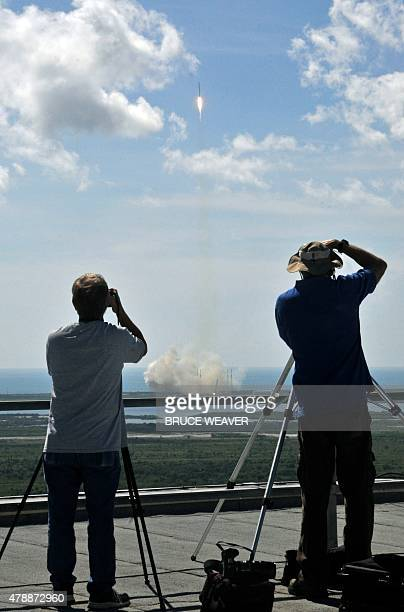 Photographers document Space X's Falcon 9 rocket as it lifts off from space launch complex 40 at Cape Canaveral Florida June 28 2015 with a Dragon...