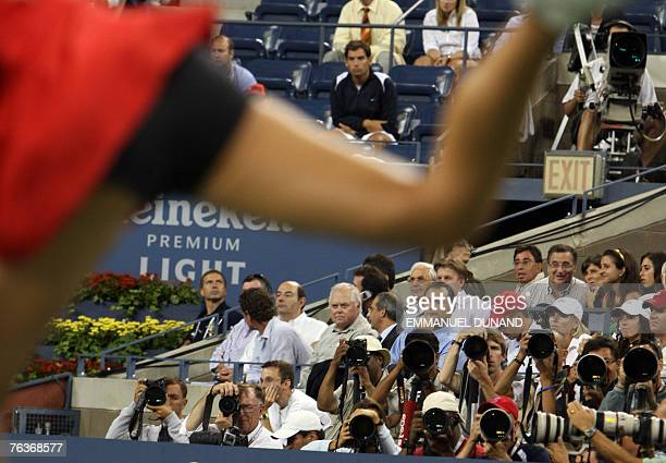Photographers focus their lenses on defending US Tennis Open champion Maria Sharapova of Russia during her first round match against Italian player...