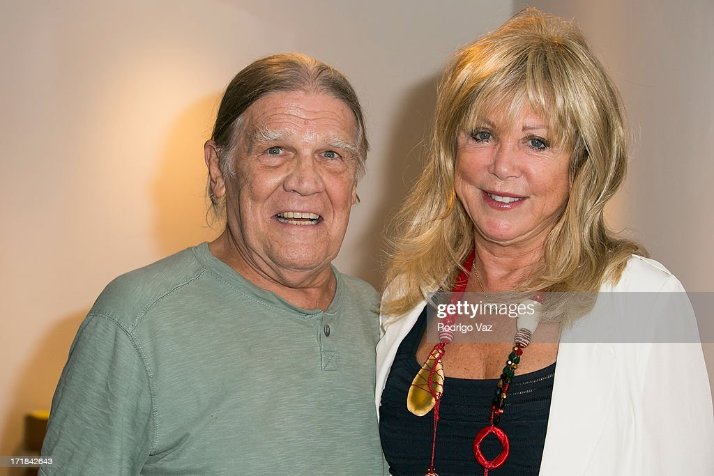 Photographers Henry Diltz (L) and Pattie Boyd attend the Pattie Boyd: Newly Discovered Photo Exhibition at Morrison Hotel Gallery on June 28, 2013 in West Hollywood, California.