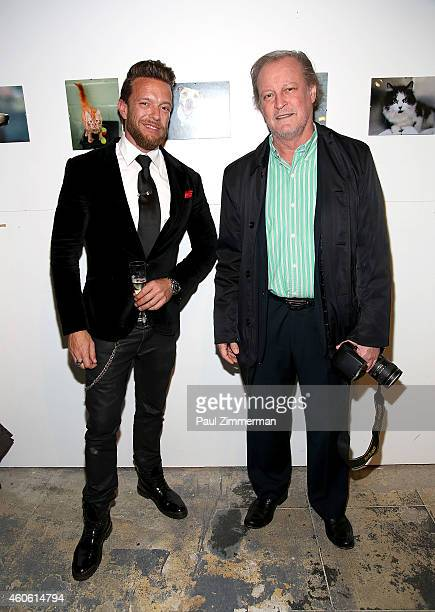 Photographers Jamie McCarthy and Patrick McMullan attend a pet portrait exhibition by Getty Images staff photographer Jamie McCarthy to benefit...