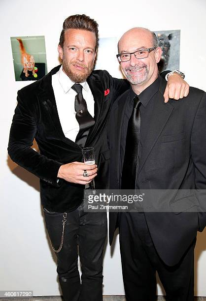 Photographers Jamie McCarthy and Paul Zimmerman attend a pet portrait exhibition by Getty Images staff photographer Jamie McCarthy to benefit Animal...