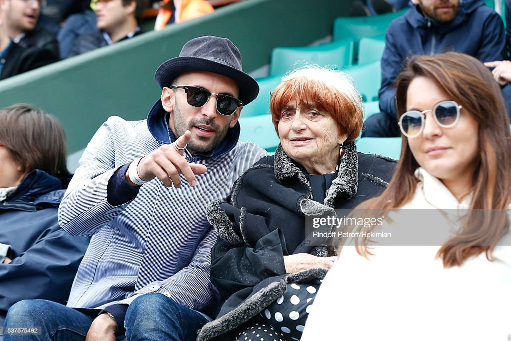Photographers JR (Jean-Rene) and Agnes Varda attend Day Twelve of the 2016 French Tennis Open at Roland Garros on June 2, 2016 in Paris, France.
