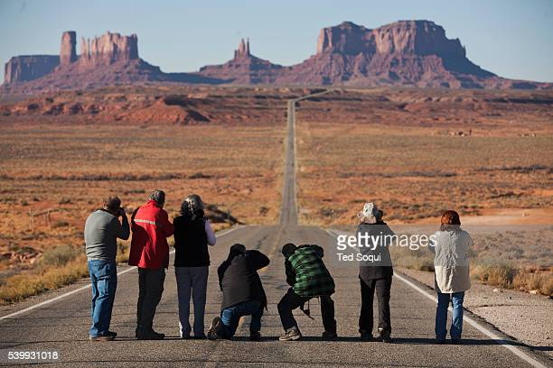 Photographers line up on a long rode in to Monument Valley This spot was also made famous in the film Forrest Gump'