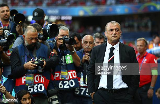 Photographers line up to photograph Fatih Terim head coach of Turkey during the UEFA EURO 2016 Group D match between Spain and Turkey at Allianz...