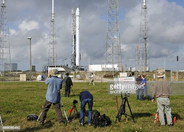 Photographers look on at the SpaceX Falcon 9 rocket as they wait for the launch in Cape Canaveral Florida on April 13 2015 The SpaceX is sending its...