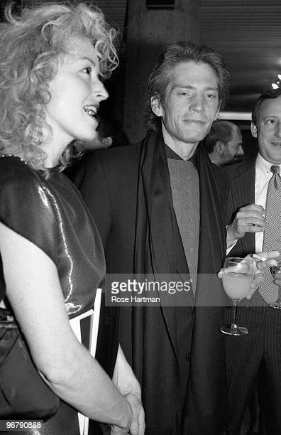 Photographers Lynn Davis and Robert Mapplethorpe attend a Sotheby's preview New York 1985