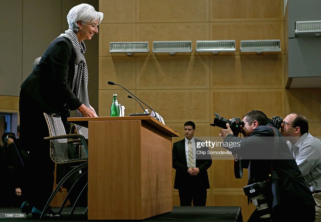Photographers make images of International Monetary Fund Managing Director <a gi-track='captionPersonalityLinkClicked' href=/galleries/search?phrase=Christine+Lagarde&family=editorial&specificpeople=566337 ng-click='$event.stopPropagation()'>Christine Lagarde</a> as she arrives for a news conference at the IMF headquarters January 17, 2013 in Washington, DC. Lagarde called the conference to discuss the IMF's economic policy priorities for the coming year.