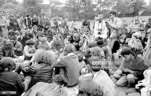 Photographers Nacio Jan Brown and Alan Copeland cover an antiwar rally on April 16 1969 at Golden Gate Park in San Francisco California