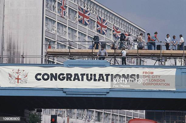 Photographers on the royal wedding procession route waiting for newlyweds Charles and Diana banners and flags adorn the bridge and building London...