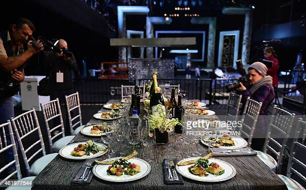 Photographers photograph the dinner setting with menu conceived by awardwinning chef Wolfgang Puck during a press preview in Los Angeles California...