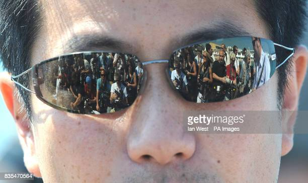 Photographers reflected in sunglasses as they wait for Robert Pattinson to attend a photocall for new film New Moon on the Majestic Pier in Cannes...