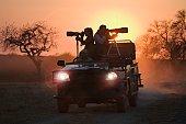 Photographers riding on all terrain vehicle