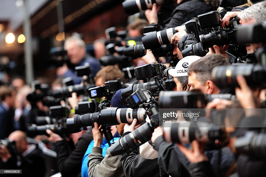 Photographers shoot the carpet at the European premiere of 'Godzilla' at the Odeon Leicester Square on May 11, 2014 in London, England.