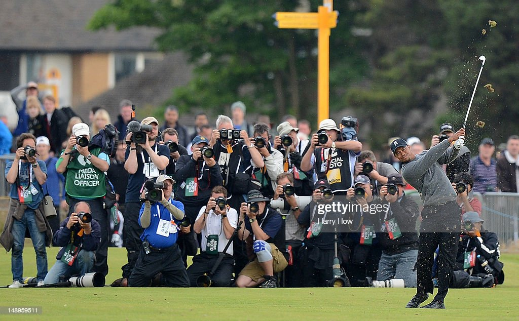 Photographers shoot <a gi-track='captionPersonalityLinkClicked' href=/galleries/search?phrase=Tiger+Woods&family=editorial&specificpeople=157537 ng-click='$event.stopPropagation()'>Tiger Woods</a> of the United States playing his approach shot to the 18th hole during the second round of the 141st Open Championship at Royal Lytham & St Annes Golf Club on July 20, 2012 in Lytham St Annes, England.