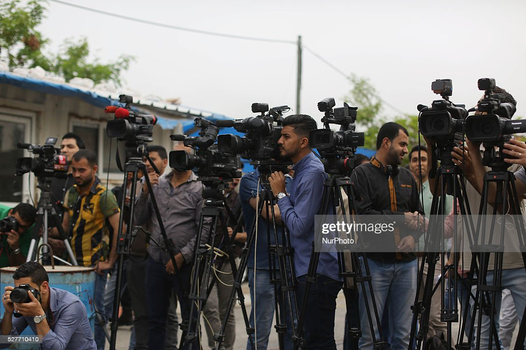 Photographers snapping pictures during a protest calling for stop the Israeli violence against journalists to mark the World Press Freedom Day, in front of the headquarter United Nation '' UNSCO '' in Gaza City, on May 3, 2016.