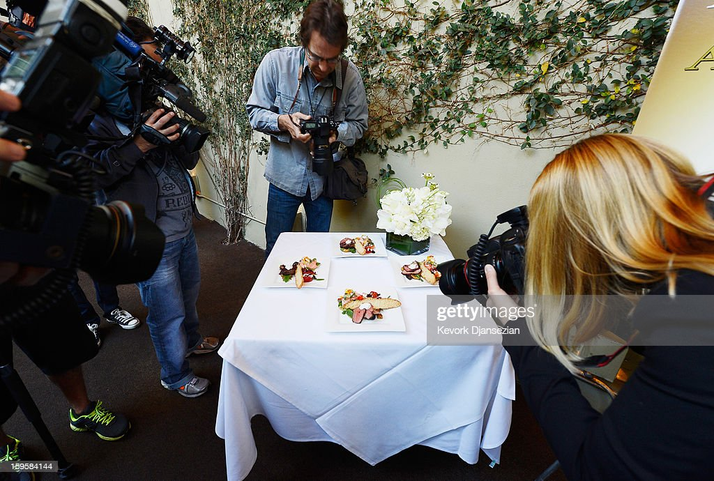 Photographers surround a table with displaying food prepared by Lucques chef Suzanne Goin which will be served at the 19th annual SAG Awards during food and wine tasting event at Lucques Restaurant on January 16, 2013 in Los Angeles, California. The 19th Annual Screen Actor Guild Awards will be held at the Shrine Auditorium in Los Angeles on January 27.
