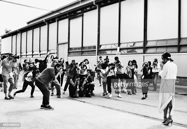 Photographers surround Nicole Warne during MercedesBenz Fashion Week Australia 2014 at Carriageworks on April 9 2014 in Sydney Australia