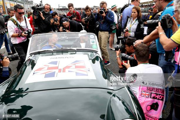 Photographers swarm around Lewis Hamilton of Great Britain and Mercedes GP on the drivers parade before the Formula One Grand Prix of Great Britain...