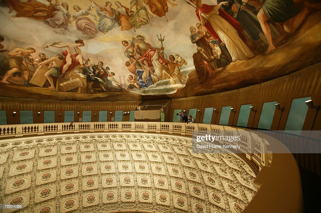 Photographers take a picture from the top of the US Capitol Dome of the crowd of people visiting the casket of the 40th President of the United...