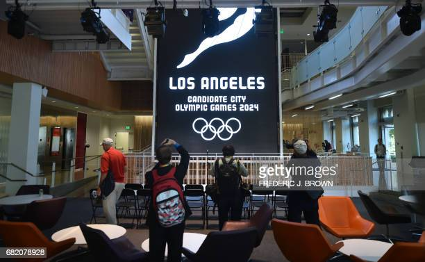 Photographers take a picture of a banner at the University of Southern California's Annenberg School of Journalism which will play host to the Main...