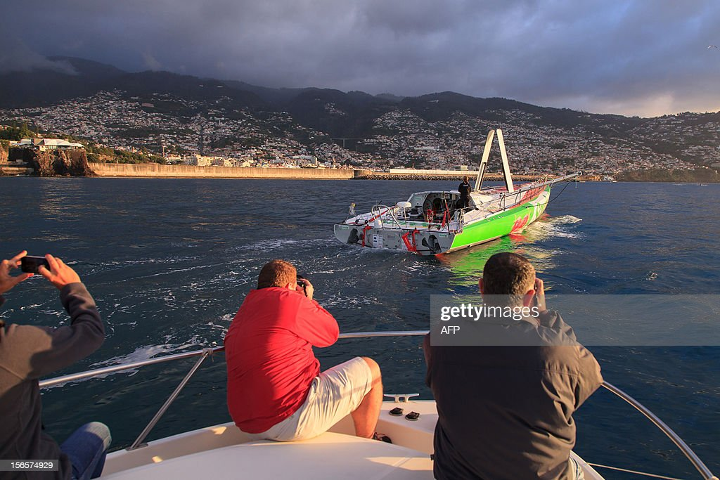 Photographers take photos of British sailor Samantha Davies arriving on November 17, 2012 in Funchal on the island of Madeira, Portugal. Davies, who was eliminated from the solo, round-the-world Vendee Globe after the dismasting of her yacht, limped into Madeira on November 17. The 38-year-old, the only woman in the world's most gruelling yacht race, saw her boat dismasted on Thursday evening in strong winds about 130 nautical miles northeast of Madeira, the Portuguese island in the Atlantic Ocean. AFP PHOTO / GREGORIO CUNHA