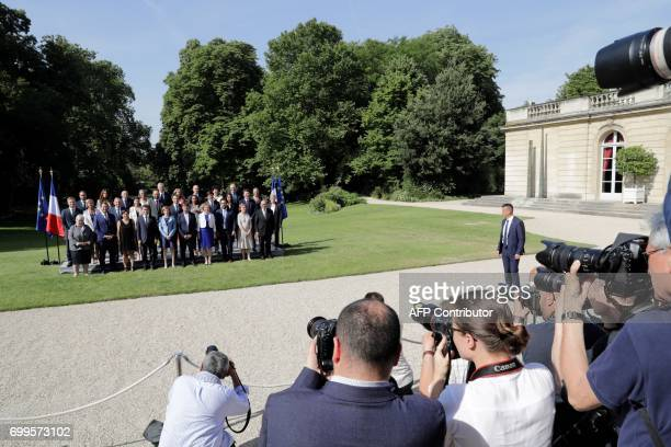 Photographers take picture of the French president Emmanuel Macron posing with the members of the governement French Secretary of State in charge of...