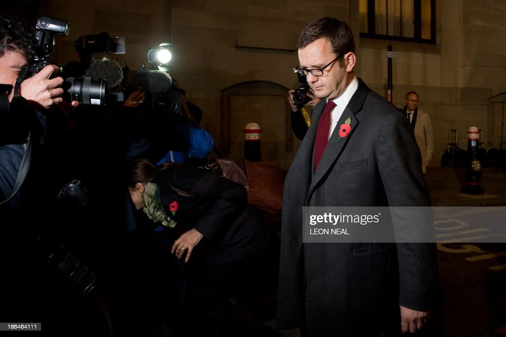 Photographers take pictures as former News of the World editor and Downing Street communications chief Andy Coulson (R) leaves the Old Bailey court in London on October 31, 2013 after another day's hearing in the phone hacking trial. Former News of the World editors Rebekah Brooks and Andy Coulson were having an affair throughout much of the time they were allegedly involved in phone hacking at the Rupert Murdoch-owned tabloid, their trial heard on October 31.