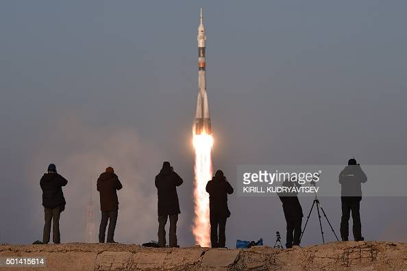 TOPSHOT Photographers take pictures as Russia's Soyuz TMA19M spacecraft carrying the International Space Station Expedition 46/47 crew of Britain's...
