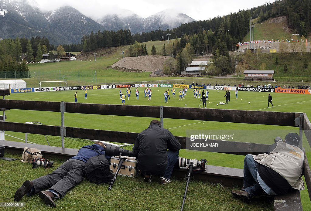 Photographers take pictures during the first Netherland's team's practice on the opening of their training camp in the Tyrolian village of Seefeld in Austria on 20 May 2010 in preparation for the 2010 FIFA World cup hosted by South Africa from June 11 to July 11.