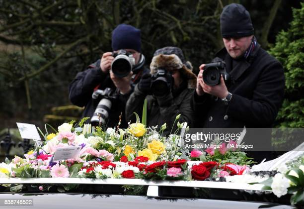 Photographers take pictures of a note from Sharon Osbourne at the funeral of former X Factor finalist Kerry McGregor at the Kirk of Calder in Mid...