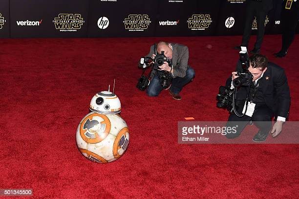 Photographers take pictures of BB8 as it rolls down the red carpet during the premiere of Walt Disney Pictures and Lucasfilm's 'Star Wars The Force...